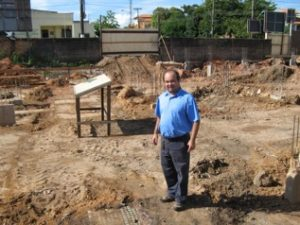 Brother Marcelo, Director of Colégio Dom Amando, at the new building site.
